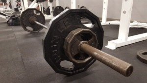 what is a deadlift image of barbell loaded with weights on the floor