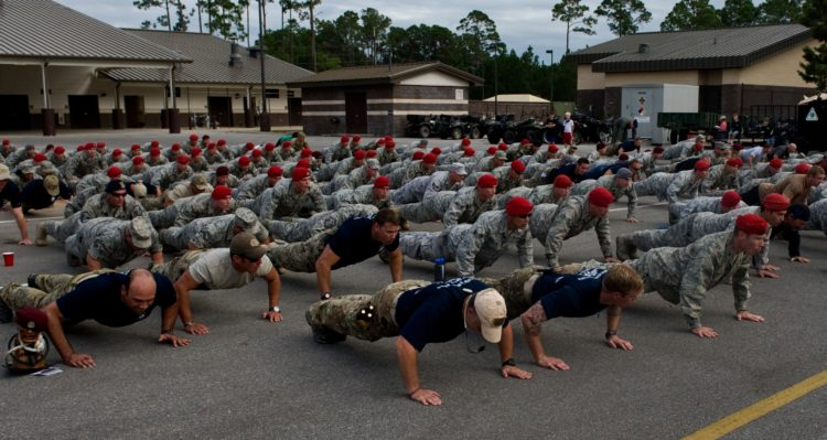 100 pushups a day challenge - U.S. Air Force Airmen participate in memorial pushups during the Tim Davis Memorial March ceremony held at the Special Tactics Training Squadron pavilion on Hurlburt Field, Fla., Oct. 26, 2011. Memorial push-ups are performed to commemorate those who have fallen in combat. (U.S. Air Force photo/Airman 1st Class Christopher Williams)(Released)