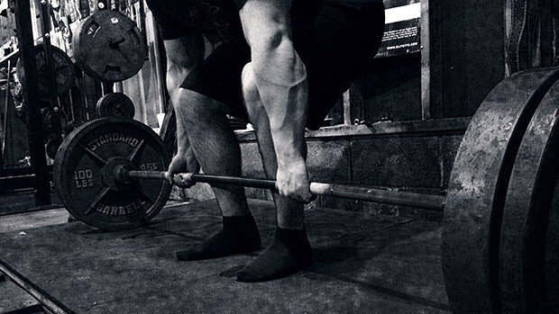 best deadlift shoes are none for many powerlifters - deadlift in socks only image