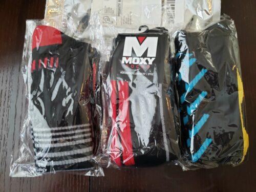 3 pairs of moxy deadlift socks in separate clear packaging